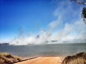 Fire on the other side of the McArthur River from the boat ramp.
